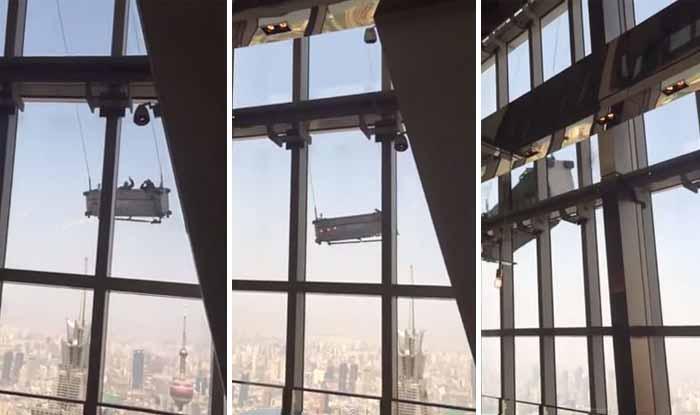 Limpavam vidros no 91 andar quando foram surpreendidos pelo vento! Arrepiante!